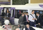 Visitors look around Hitachi, Ltd.'s booth at InnoTrans in Berlin.