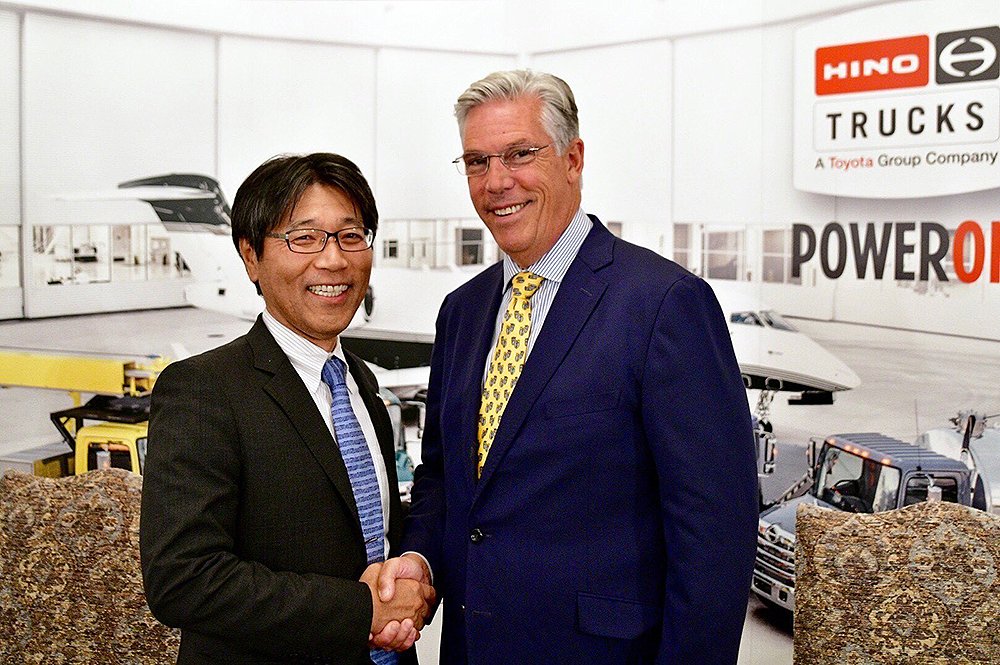 (Left to right) Hino Motors Manufacturing U.S.A. President Takashi Ono and West Virginia Department of Commerce Secretary H. Wood Thrasher